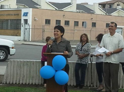 Mishal Montgomery, aide to mayor Tom Tait, speaks at OCCCO pro-district rally.